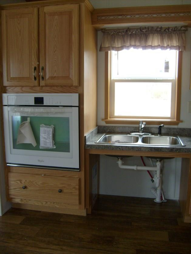 Roll under kitchen sink & lowered wall oven