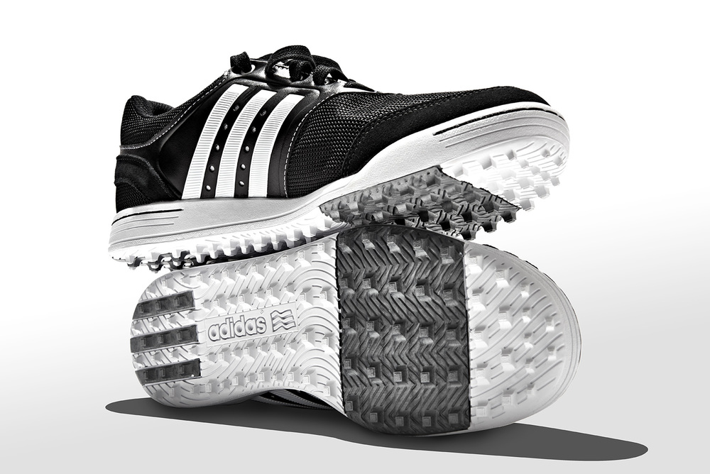 casual adidas golf athletic shoes showing texture on sole with dramatic lighting