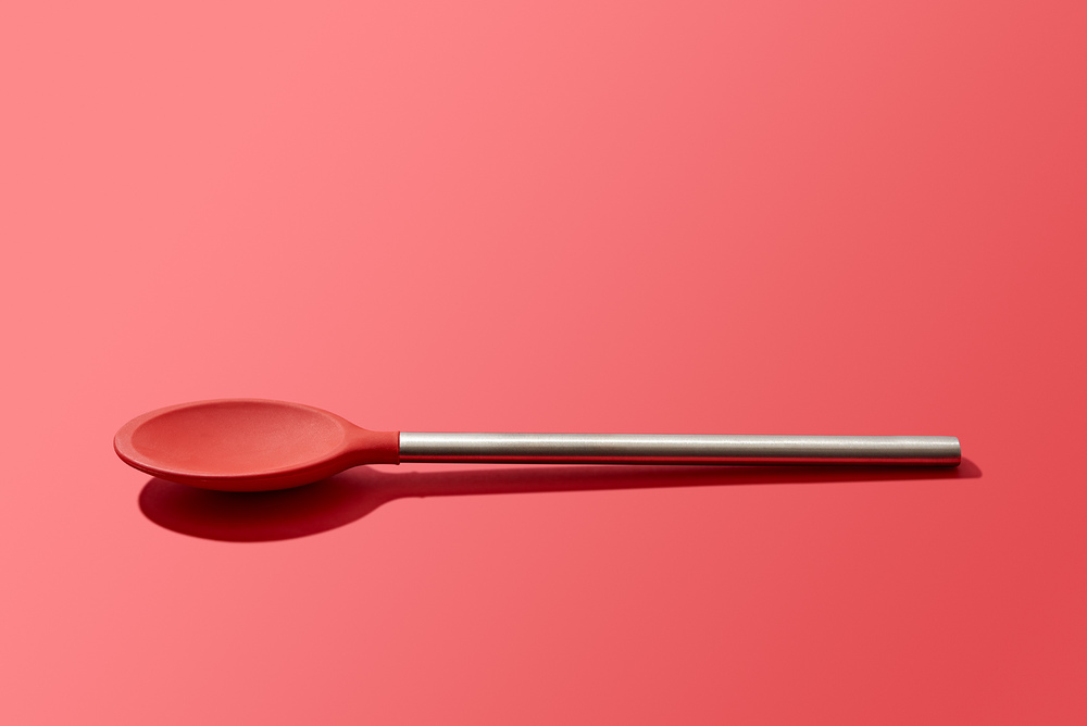 modern design kitchen spoon utensil on red background