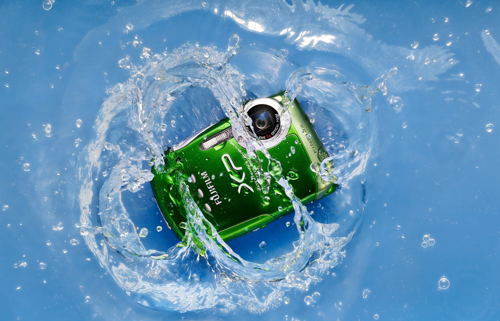 waterproof vivid bright green camera splashing in water made by fuji