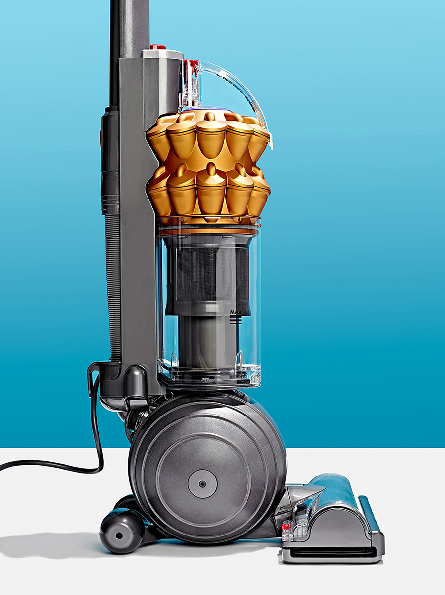 great modern product photo of Dyson Ball Vacuum Cleaner on Bright studio background