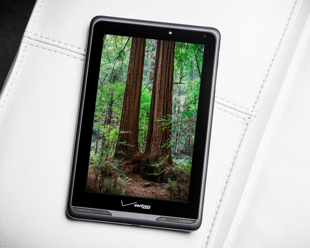 stunning product photo of Verizon lte 4g tablet with redwood forest screen on white couch