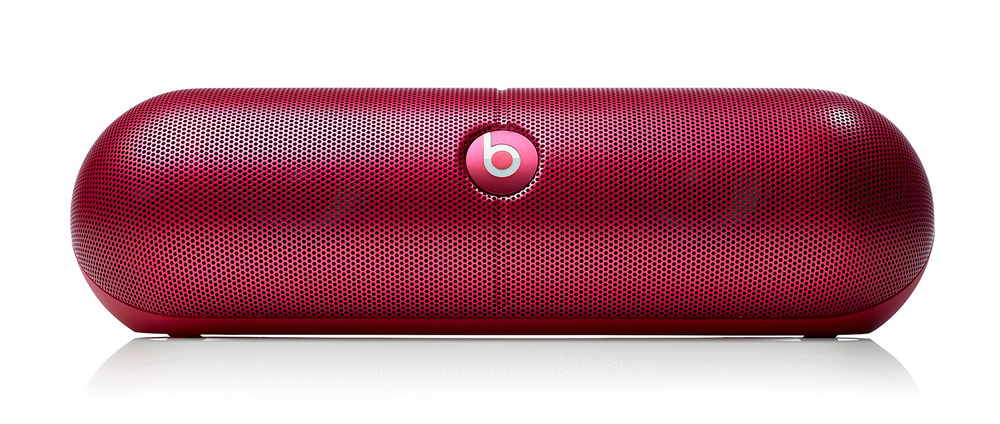 Beats pill red bluetooth speaker on white background from product photo studio