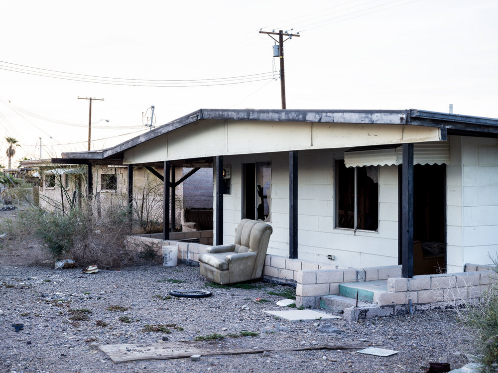 Bombay Beach decaying house with couch in yard
