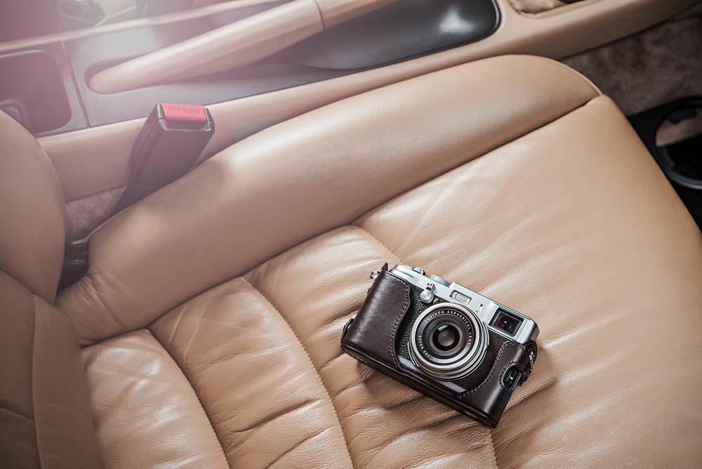 Fuji camera on a Porsche car seat