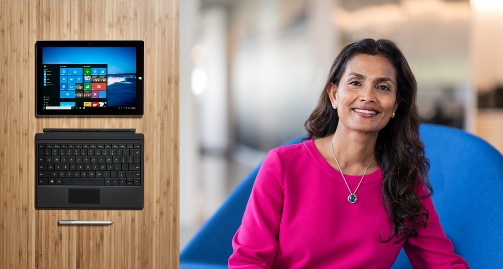ethnic attractive strong woman in lifestyle portrait next to tablet still life