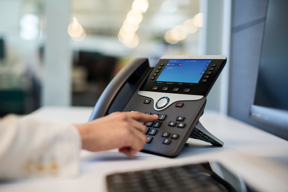 cisco IP phone used by Woman in tech company