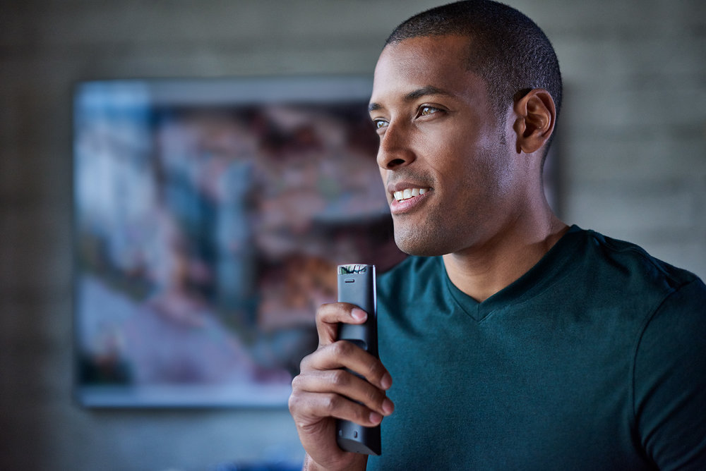African American man talks into a remote