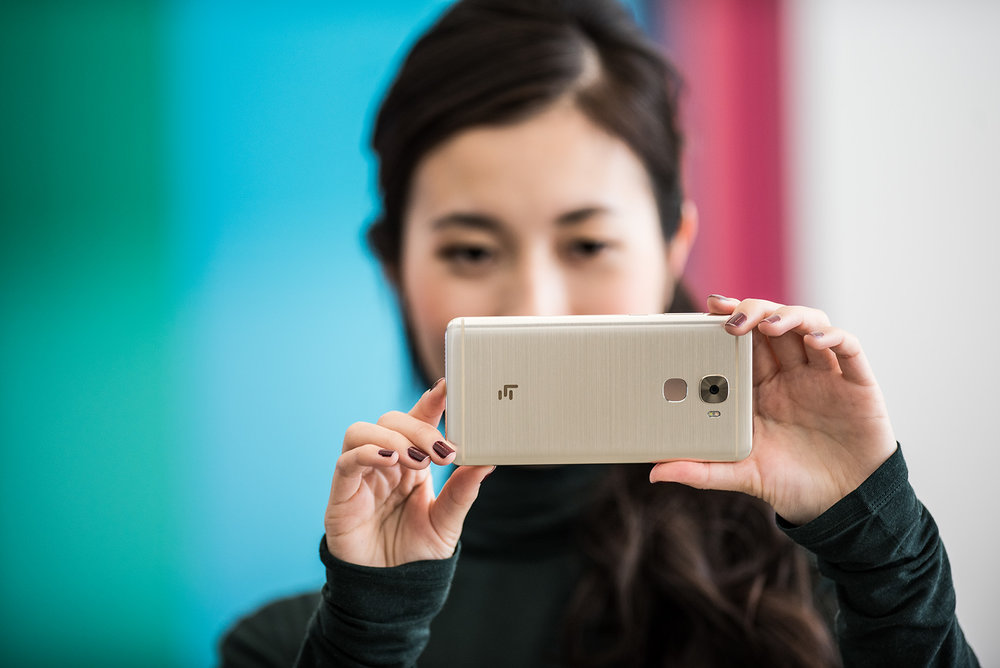 Woman takes a photo on a LeEco cellphone