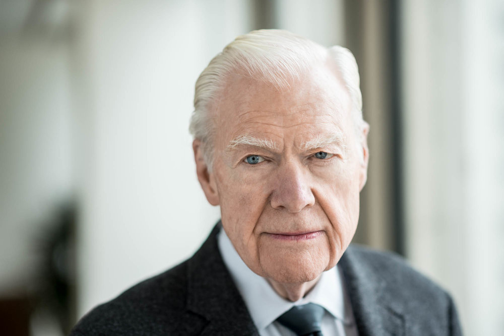 corporate portrait of an older man in professional business clothing