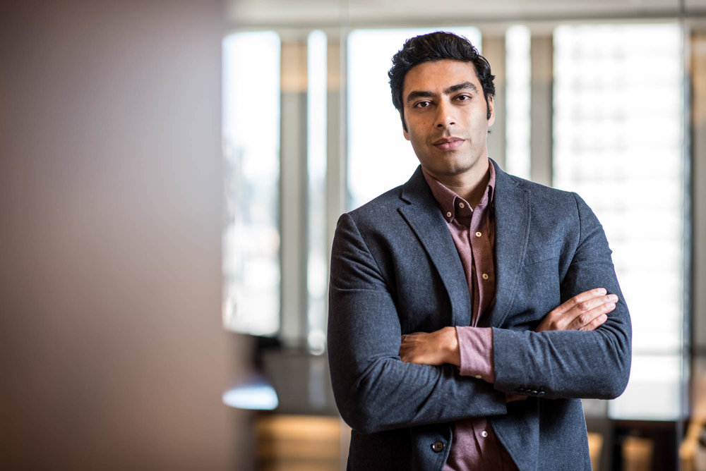 corporate portrait of a young Indian man in professional business clothing