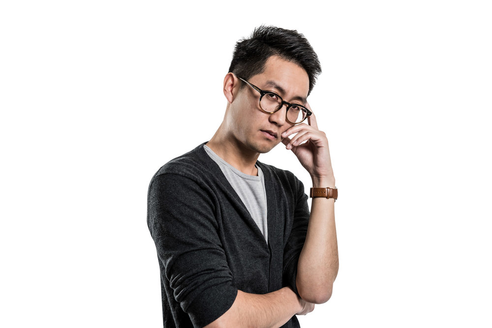 Asian american young man with glasses posing for a Silicon Valley Comic Con portrait photo shoot