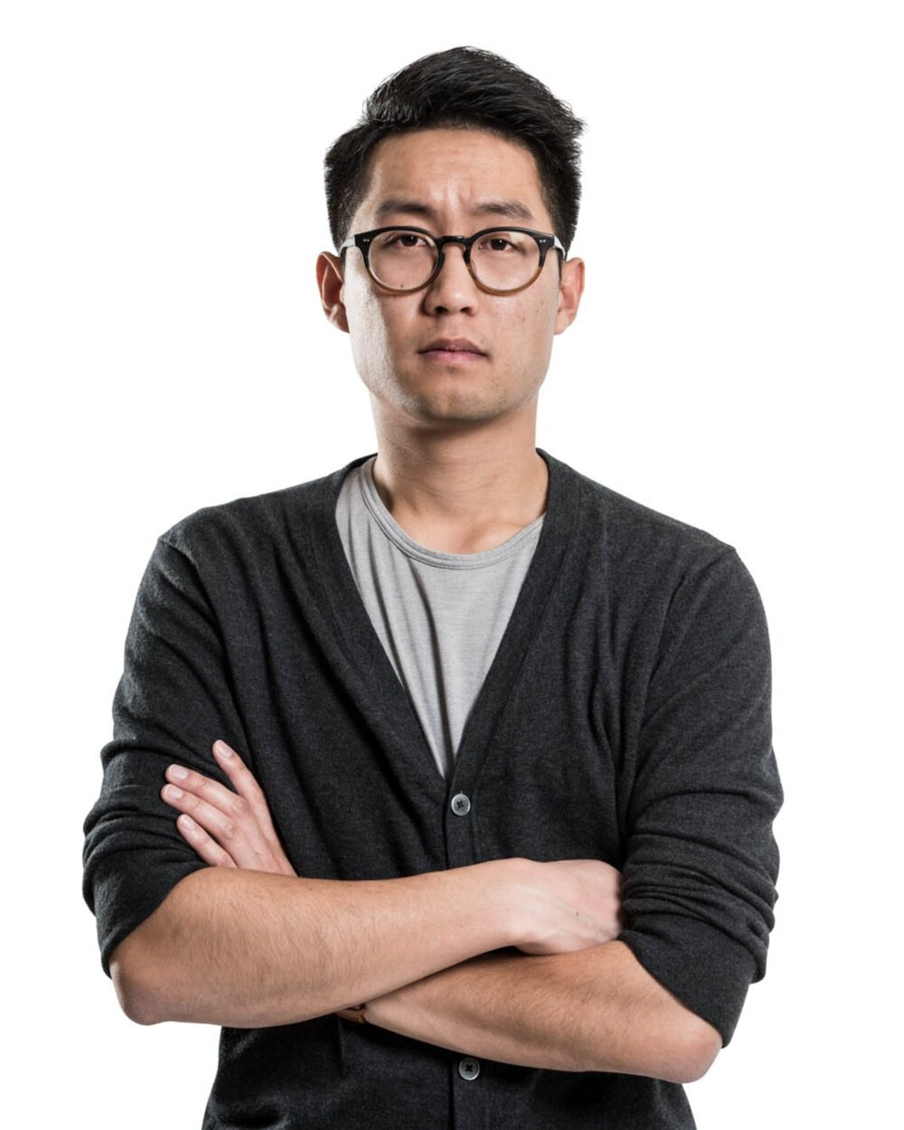 Young asian man with glasses crossing his arms