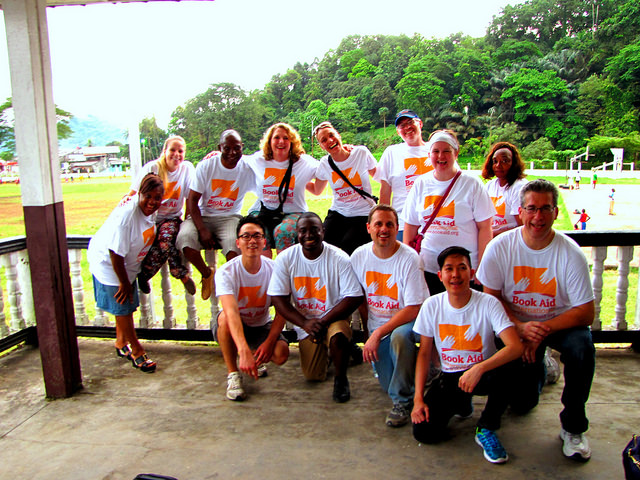 The Recognising Those Who Care delegation, consisting of representatives from Elsevier, Lexis-Nexis, Book Aid International, and EISERVI in Limbe, Cameroon, in November 2014.