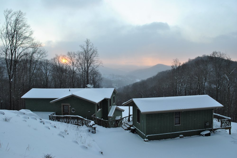 Main house and cabin in snow (View from behind the house)