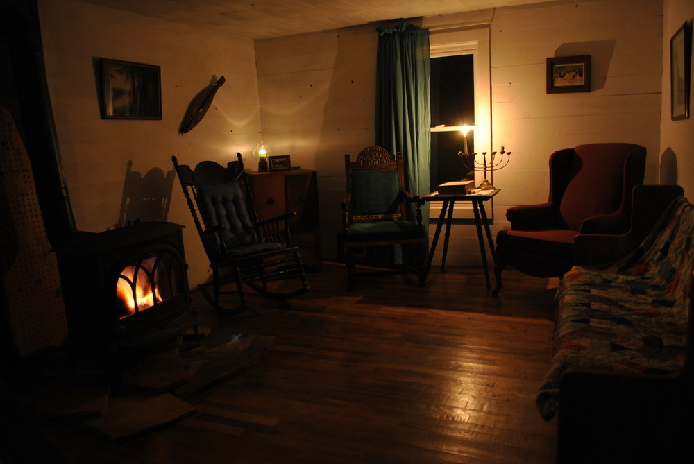 Living Room at night with woodstove