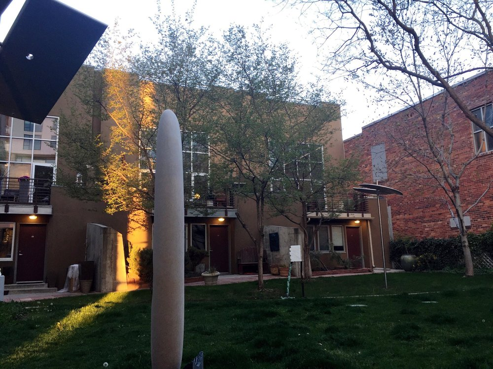 Cutest sculpture garden and townhomes behind the gallery