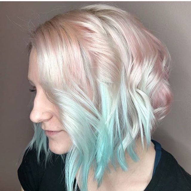 Next! While we are at it, here's a rendition of pastels by @_mo_moments she was able to achieve this look by using #keune lightener along with #joico intense colors. Melting a yummy bubble pink to a sultry sky teal. Wow. #pdx #pnw #portland #aline #curls #pastel #texture #professional #melt #intensity #color #custom #creation #fabulous #alien #coworker #loveyourself #loveyourhair #duh