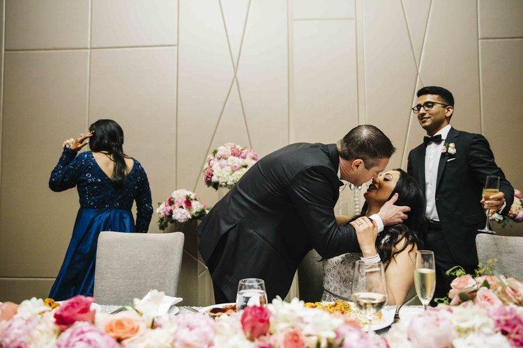 wedding photographer videographer kiss reception.jpg