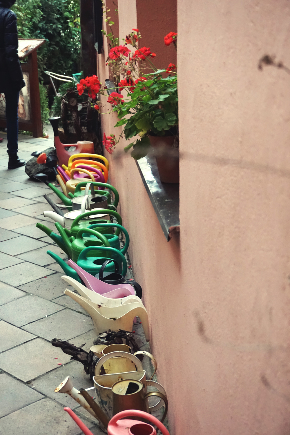 Colourful Prague watering cans