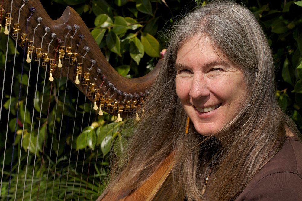 Shelley Phillips - harp, voice, celtic modes   Shelley Phillips has a Masters of Music from the San Francisco Conservatory of Music. She plays and tours with The Anjali Quartet and The Coulter/Phillips Ensemble, performs as a duo with her husband, Barry Phillips, sings Shape Note music, and has collaborated with Rumi translator and poet Coleman Barks making two albums of poetry and music. Shelley has appeared on more than 20 albums on the Gourd music label, including her solo albums The Fairie Round, Pavane, The Butterfly, and The Wood Between the Worlds, as well as a duet album with Barry called Wondrous Love. She also has recorded music of the Shakers and produced a benefit album, Verdant Groves, for the Shaker village museums. In addition she teaches at several other summer programs, including founding the Boxwood Flute Festival's children's, teens' and seniors' programs in Nova Scotia and teaching music related crafts at various primitive skills gatherings in the west. Shelley also works as a music director within the Episcopalian church and is the founder and executive director of Community Music School of Santa Cruz, where she runs Celtic Camps for children, teens and adults, concerts, workshops, and other programs. She lives on the foggy California coast with her husband and her very spoiled cat.