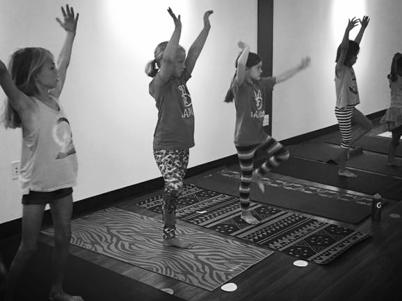 AM Kids - ELEMENTARY. - Ages 4-10 yearsThis fun and energetic class will improve:· Strength, flexibility, and coordination.· Attention· Self regulation· Relaxation, stress management· Sense of community and belongingClasses empower young yogis, build community, teach respect for self and others, as well as foster an awareness of the body and mind.Classes incorporate the AM sequence, with breakdowns of more challenging poses, partner and group poses, yoga games, and mindfulness activities.