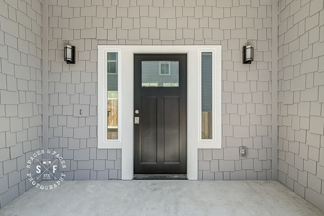 Love the entry detail and gray/black color scheme at this East Austin home by @mx3homes. #eastaustin #blackdoor #ausinliving #austinrealestate