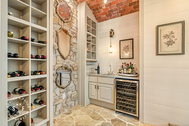 This wine room used to be the old entrance at this Lakeway home. What a great use of space! Interiors by Judi Fuller Design #wineroom #austinliving #austinphotographer #lakewaytx #spacesatx