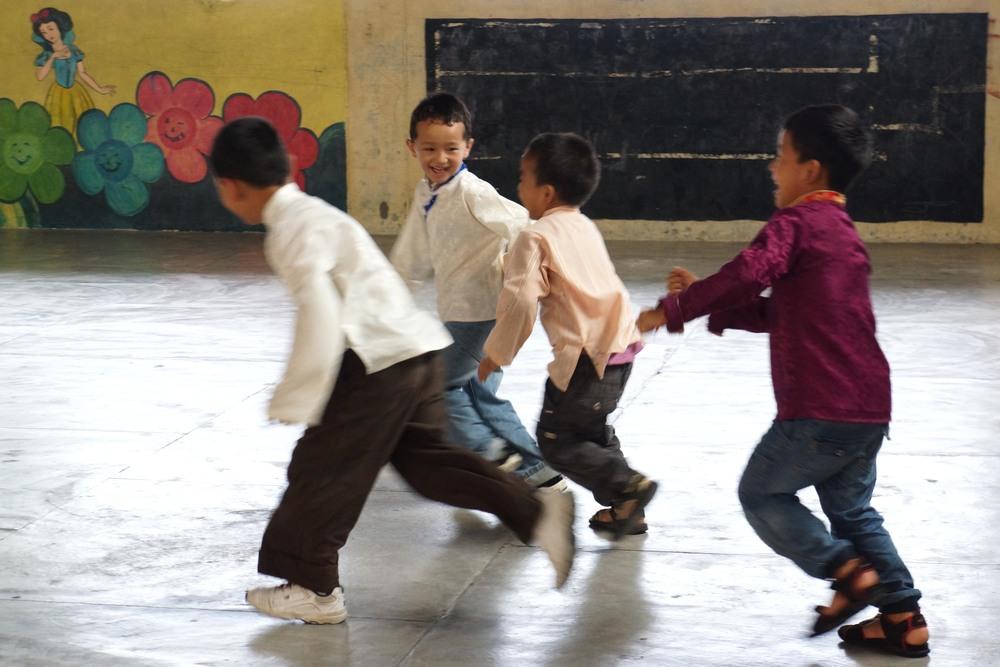 Tibetan children running and playing
