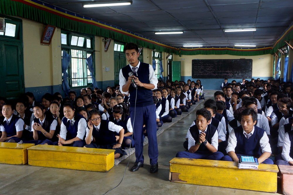 A Tibetan student stands to ask a question