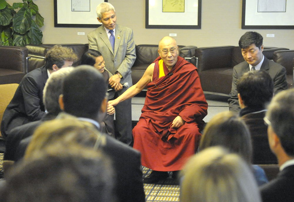 Image of Dr. Michael McCullough (far left), Ana Rowena McCullough (left center, foreground), His Holiness the Dalai Lama (center), Sikyong (Prime Minister of Tibet) Lobsang Sangay (right), and others sitting