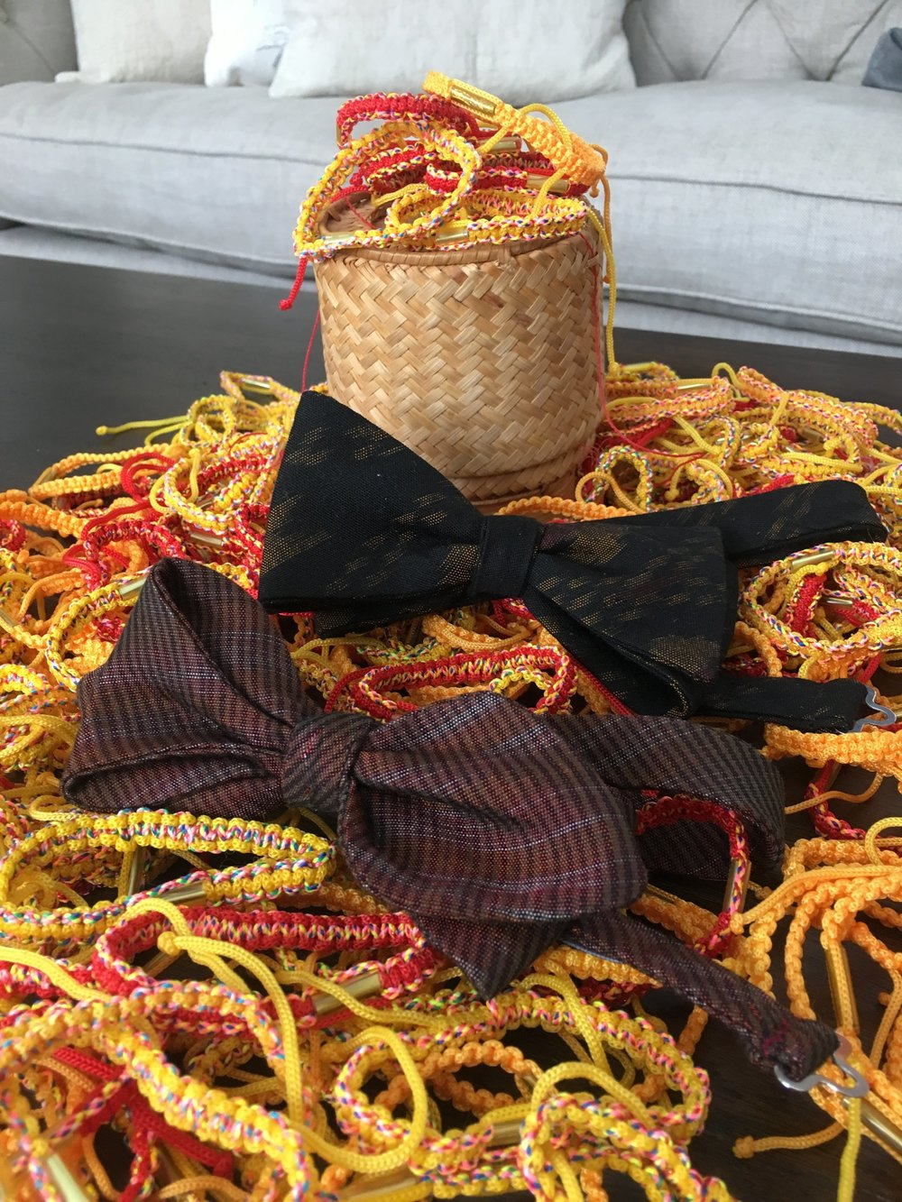 Bow ties repurposed from traditional Lao women's textiles