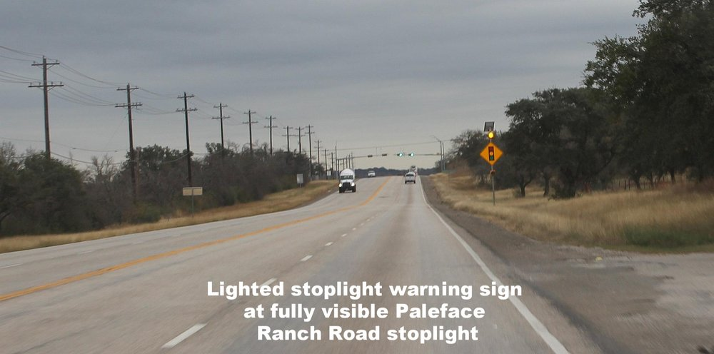 Stoplight warning sign at fully visible Paleface Ranch Road.jpg
