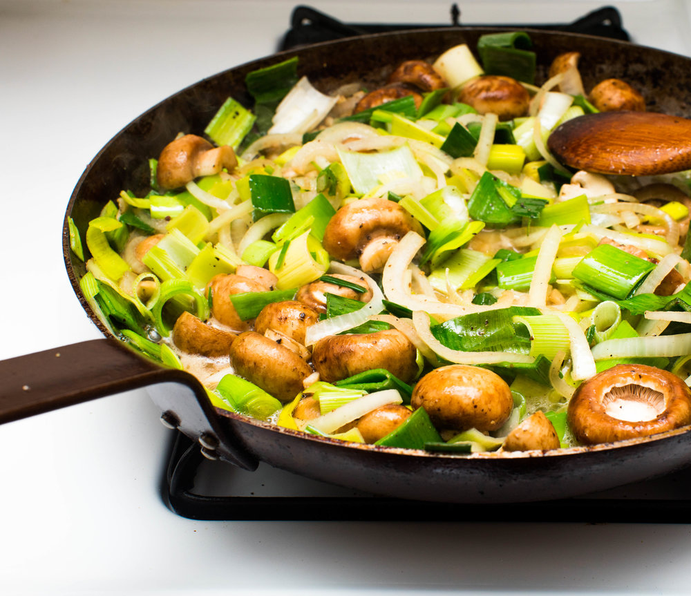 Cook the mushrooms and leeks until almost all the liquid has evaporated. -