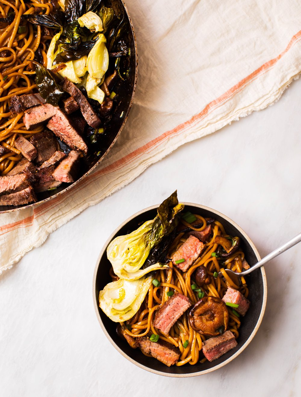 Cut the steak into bite-sized cubes before tossing with the noodles. -