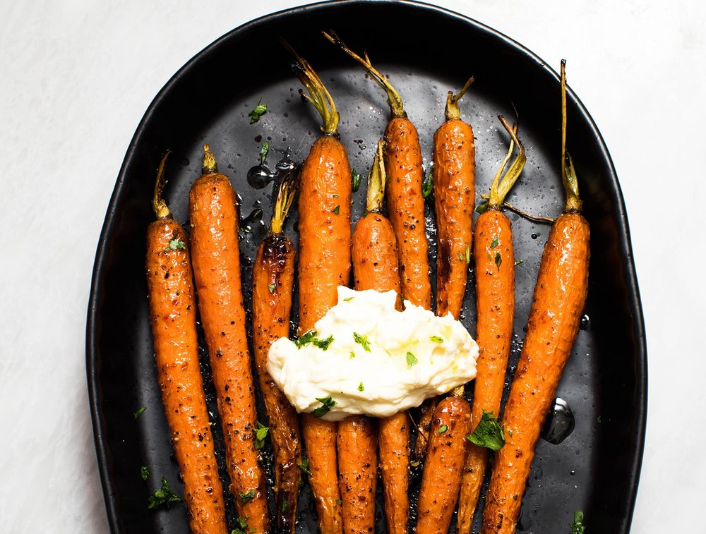 Harissa-Maple Roasted Carrots with Whipped Ricotta - Get the recipe here.