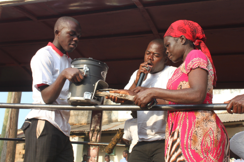 Marketers hired by Boma Safi carry out a public forum demonstrating Boma Safi's products in Kakamega, western Kenya.