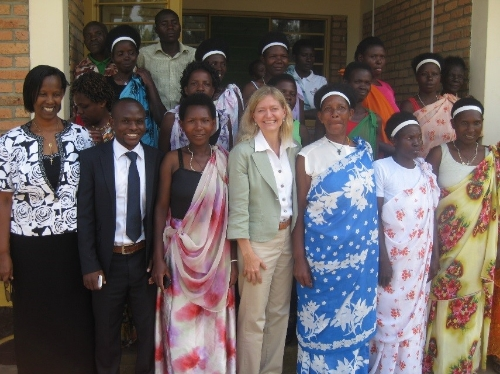 Members of Izihirwe Fromagerie Cooperation with U.S. Ambassador Erica J. Barks-Ruggles