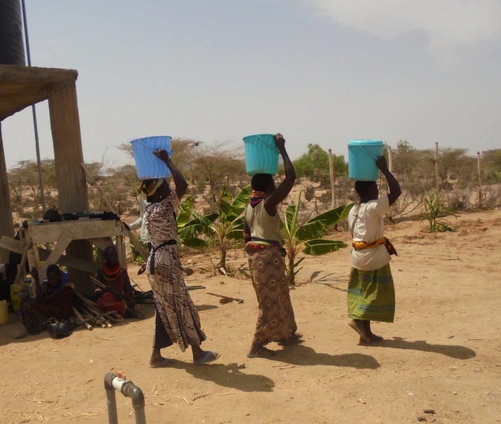 Photo: Achukule members drawing water from their borehole in Lokichar, Turkana County, Kenya in February 2016