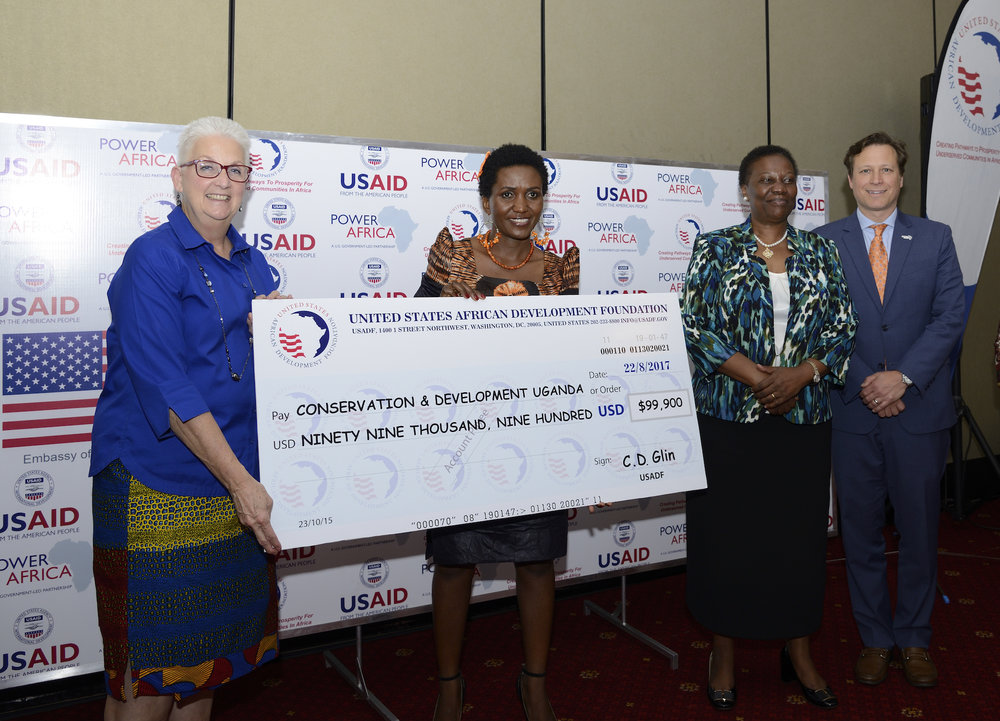 Ambassador Malac, Power Africa Coordinator Andrew Herscowitz and Hon. Irene Muloni, Minister of Energy and Mineral Development, award CEO of CODE Uganda. USADF, a Power Africa partner, awarded 2 grants to women-owned energy enterprises in Uganda in August 2017.