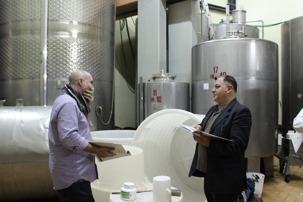 Christian starstruck by celebrated winemaker Salvatore Moletierri as he shows wine tour guests the behind-the-scenes of his wine production.
