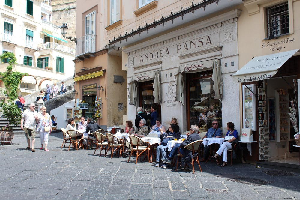 "Guests of "" Campania Past & Present Tour "" visit Andrea Pansa Pasticceria after traveling to Amalfi by ferry from Salerno."