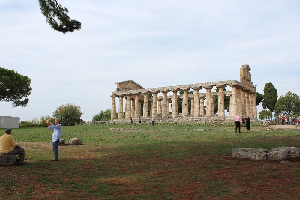 October 2015 tour guests explore the Greek temples at Paestum.