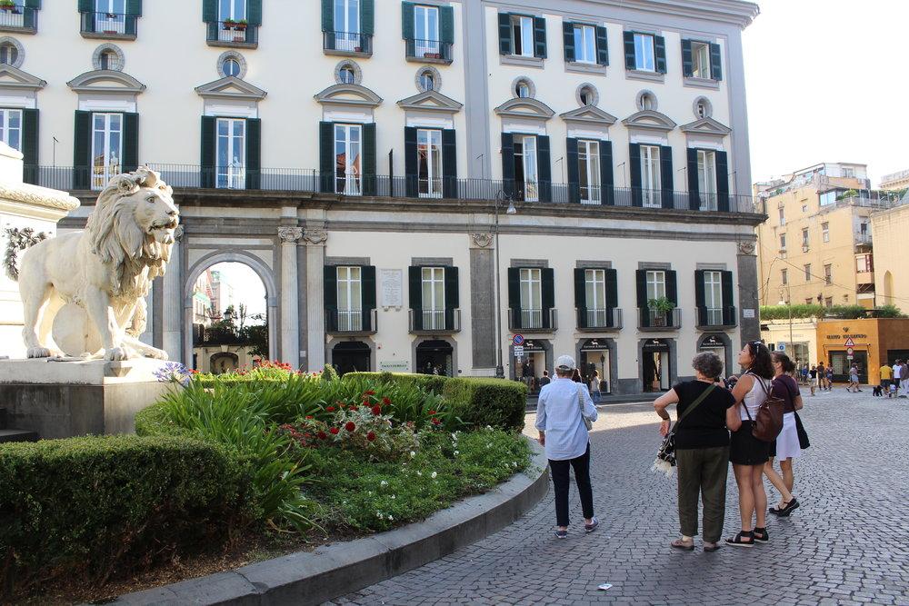 Viewing the lions in Piazza dei Martiri near where Lila had her shoe salon