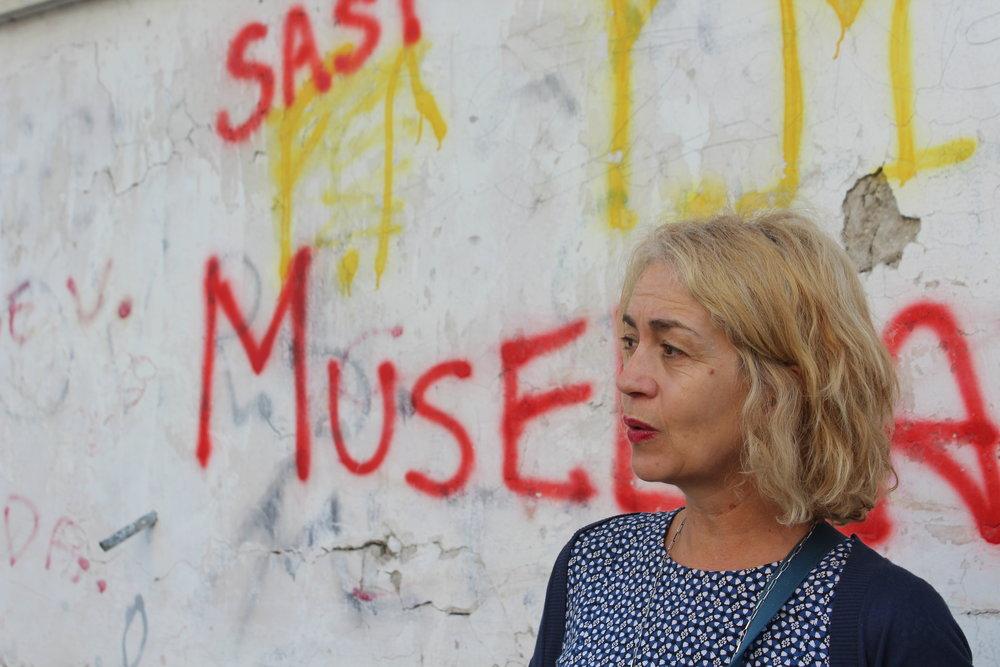 Guide Francesca Sinaschalchi discusses contemporary life in Naples's Rione Luzzatti