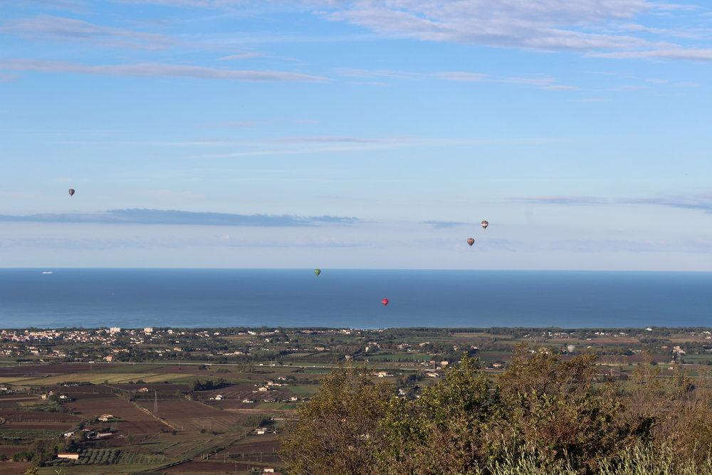 View of hot air balloon festival and the Tyrrhenian Sea from Capaccio