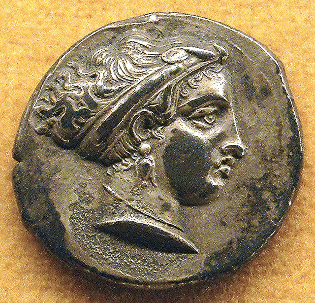 Silver coin of Neapolis / Naples with head of the Siren Parthenope (beginning 4th century BC) - Naples Archaeological Museum