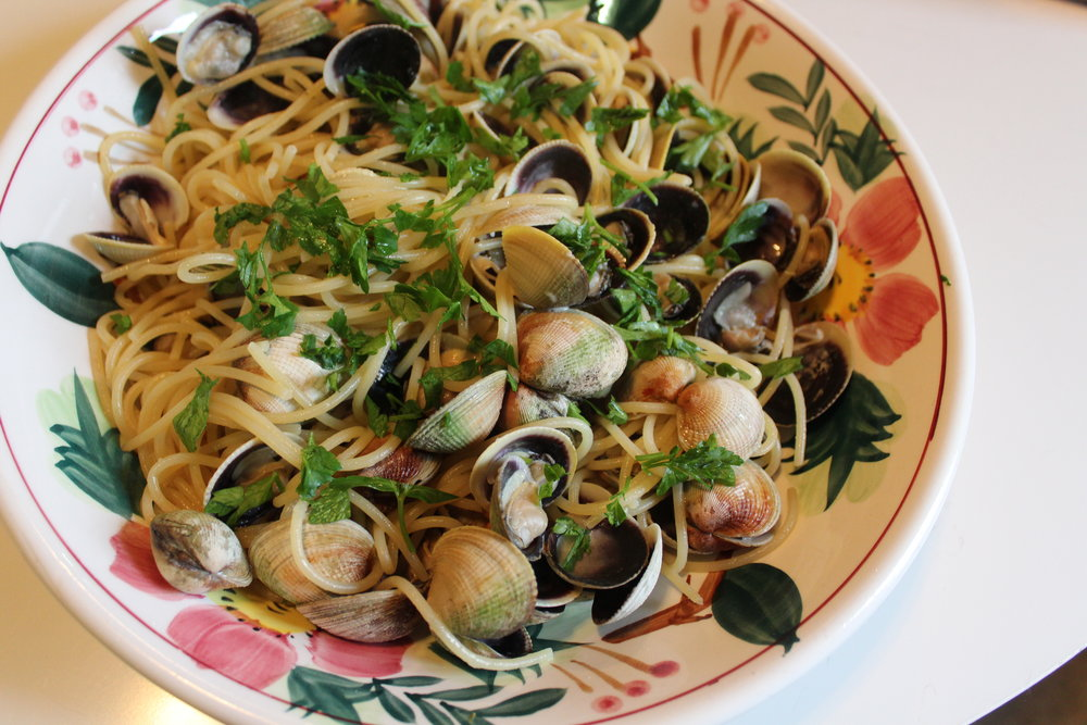 The best spaghetti vongole recipe has you finish cooking the pasta in the clam juices so all the flavor can be absorbed.