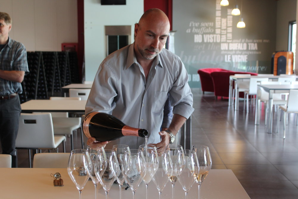 Co-host and sommelier Christian Galliani pours Joi, a sparkling rosé at San Salvatore's tasting room amidst the vines.