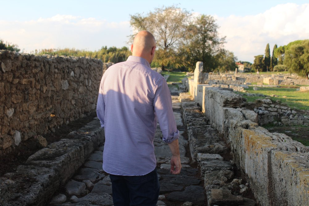 Tour co-host Christian Galliani walking along ancient roads in Paestum's archaeological park.